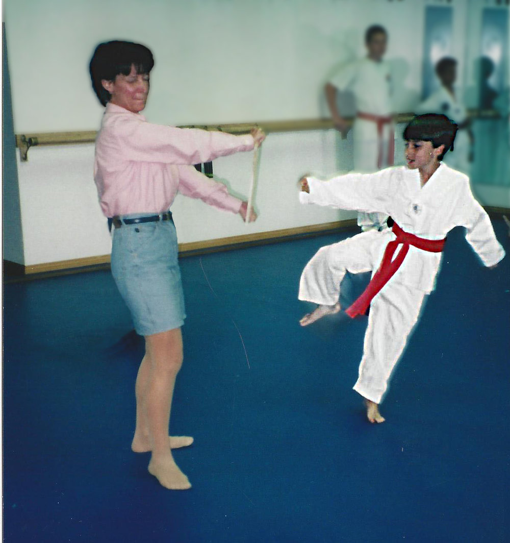 Daniel kicks board with mom.jpg