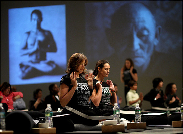 Donna Karan, left, and Sonja Nuttall, co-founders of the Urban Zen Foundation, introducing their yoga program to officials of Beth Israel Medical Center. Credit: Chang W. Lee/The New York Times