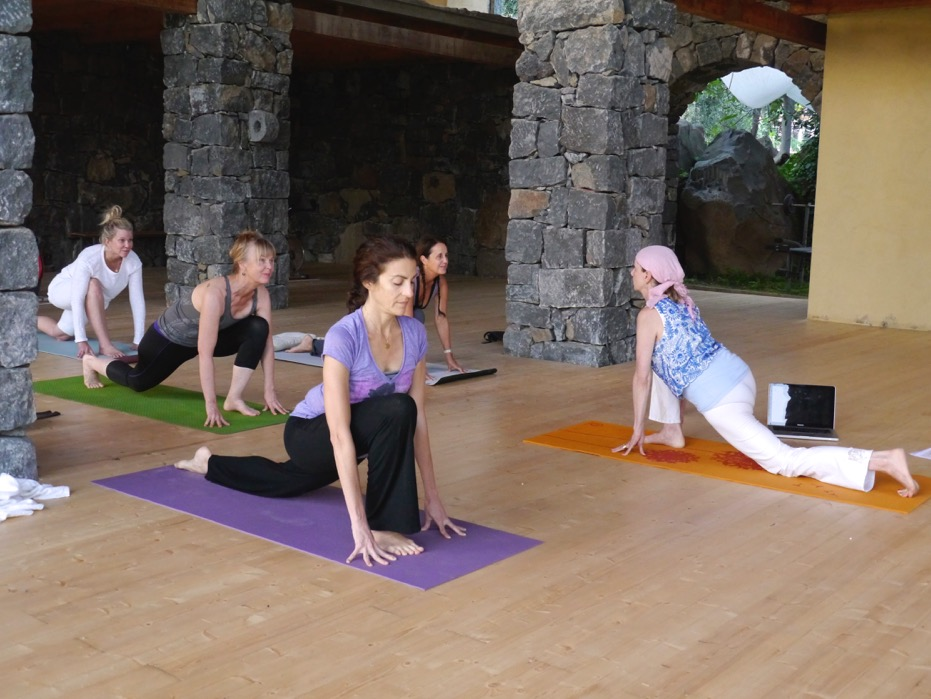 Leading morning Kundalini Yoga class on retreat in Sicily, Italy.