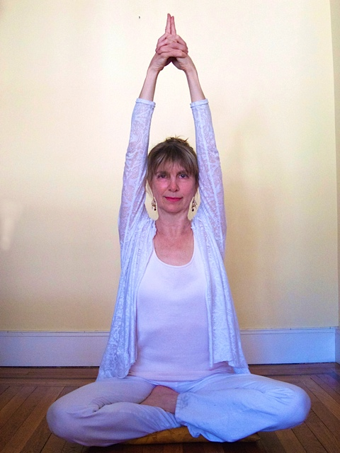 Practicing Sat Kriya, a Kundalini exercise to tone the nervous system and aid digestion.