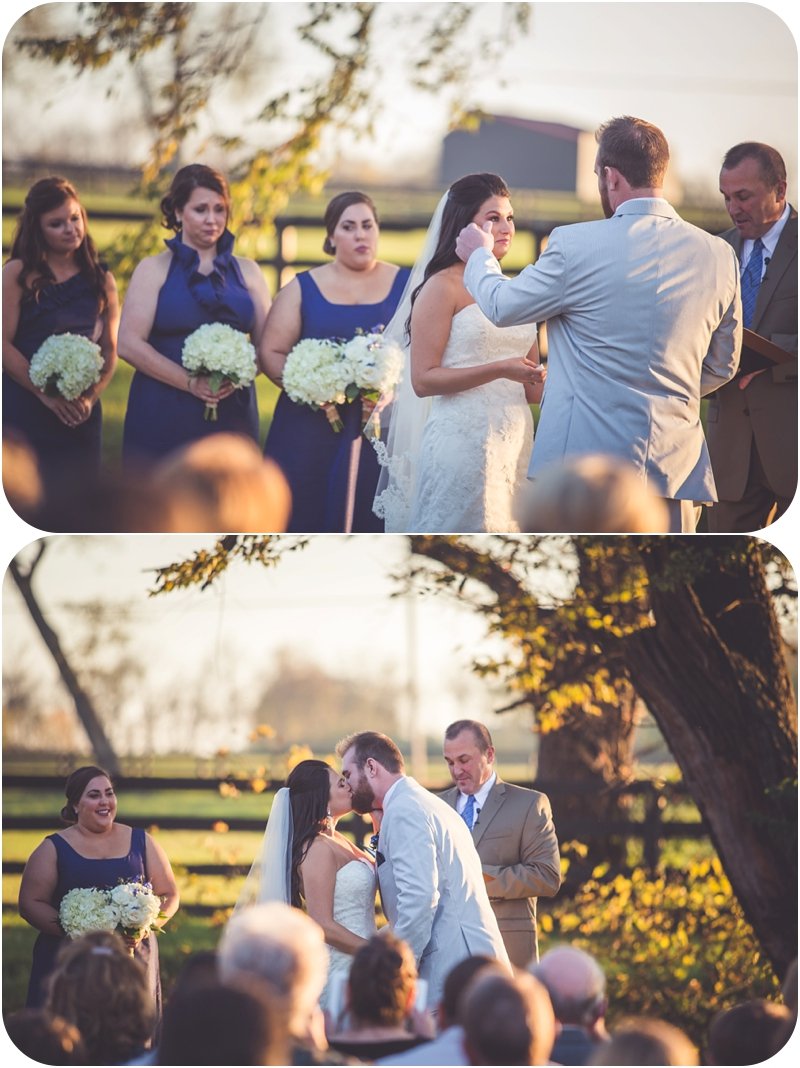groom wipes tear from brides eyes during sunset farm wedding ceremony lexington