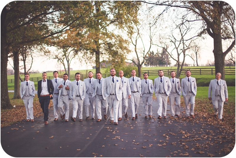 big bridal party of groomsmen, groomsmen walking at fasig tipton wedding