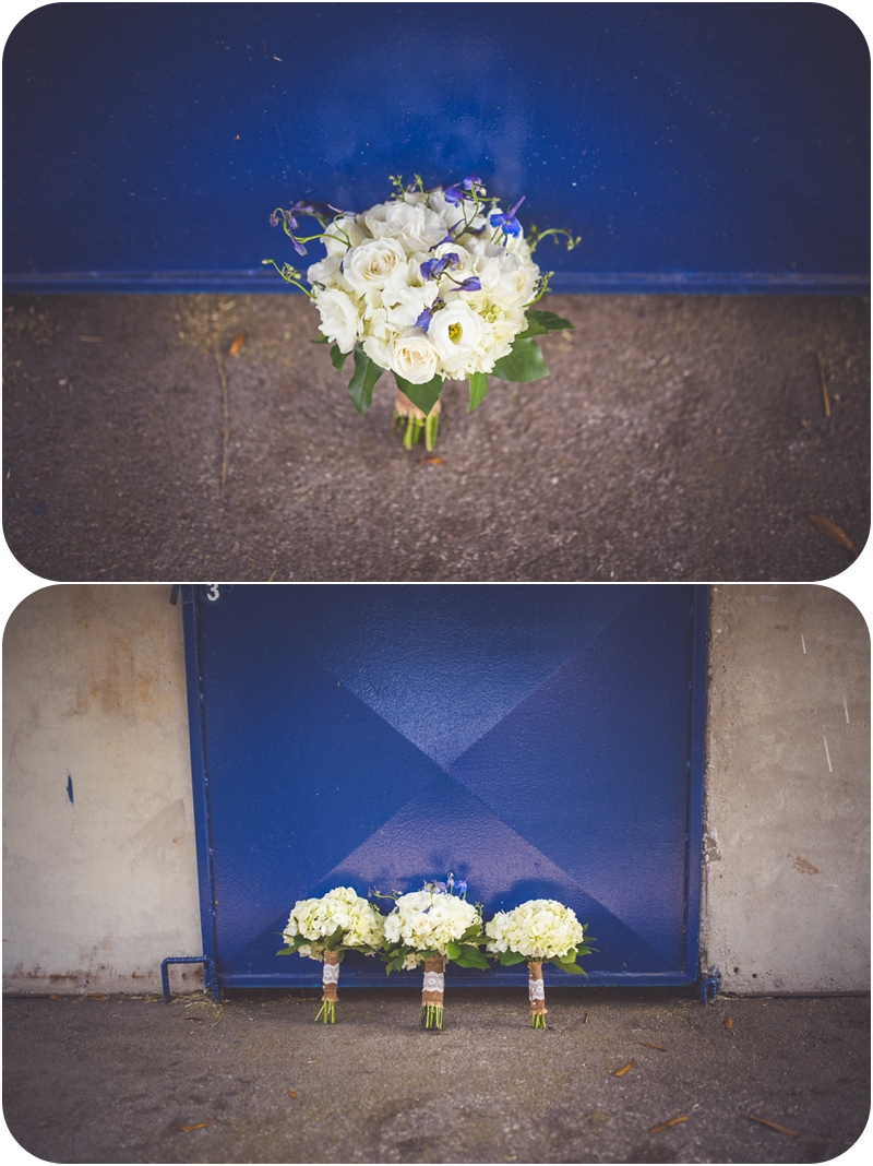 fasig tipton farm wedding bouquets on blue barn door