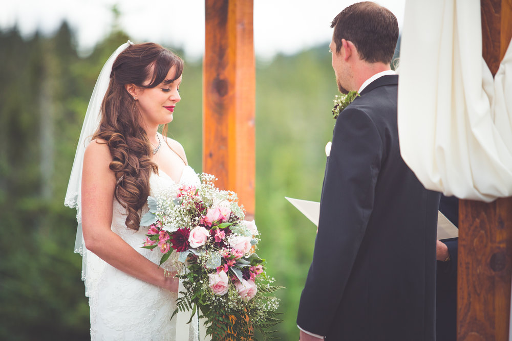 bride closes eyes during prayer at mount washington wedding