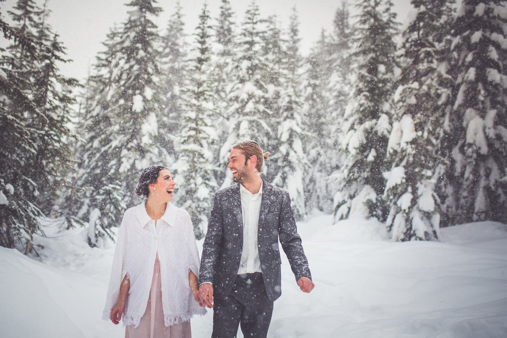 bride and groom laughing at snowy winter wedding at mount washington resort