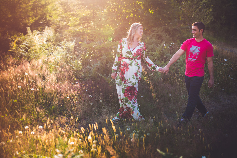 golden hour engagement photos in Qualicum Beach field
