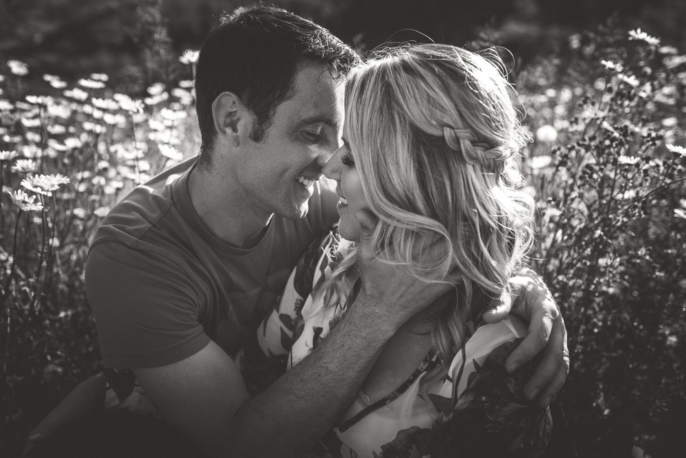 black and white couples portrait amongst daisies