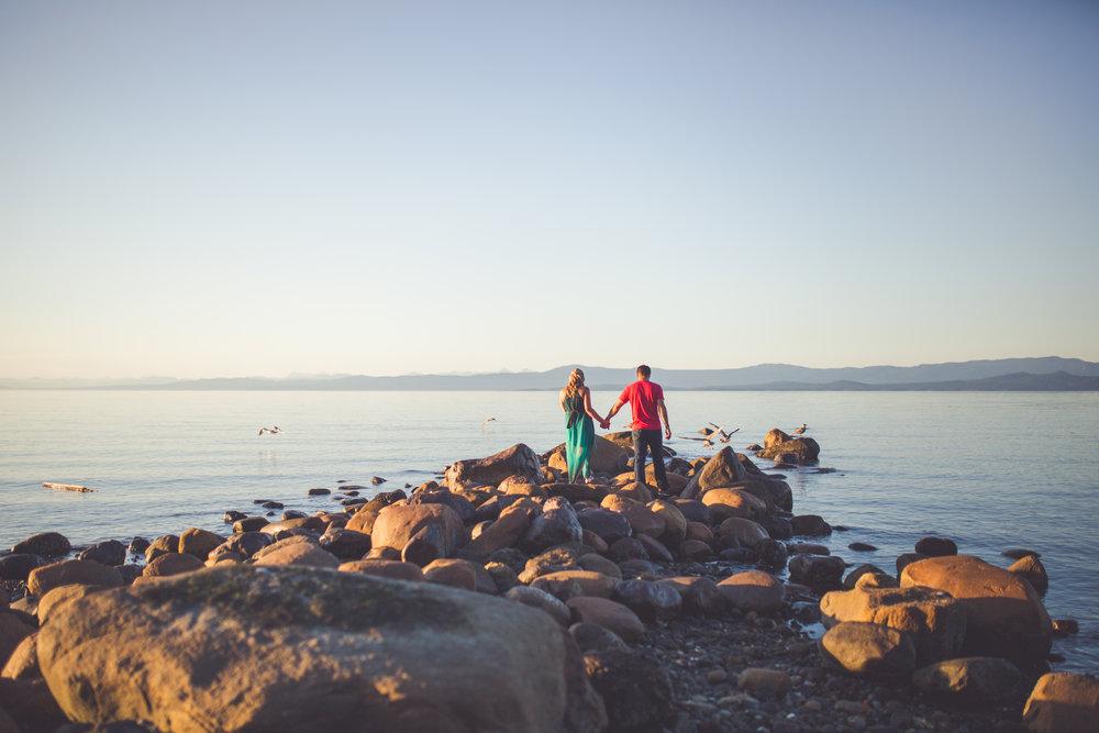 couple walking beach at sunset in Qualicum Beach