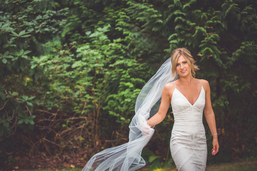 veil blows in the wind at Vancouver island wedding