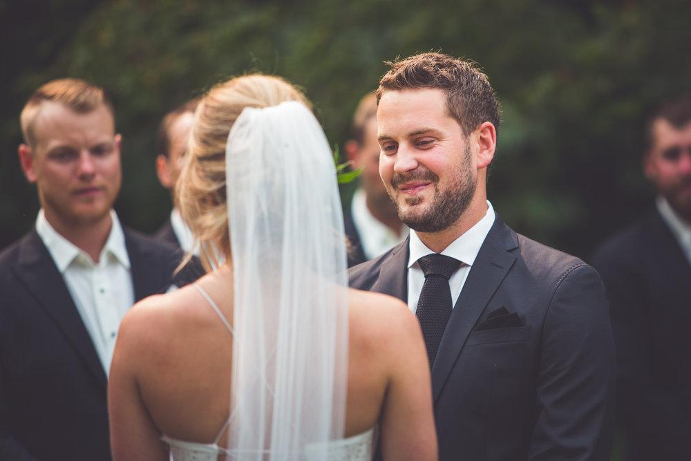 groom smiles at bride during Qualicum Beach wedding