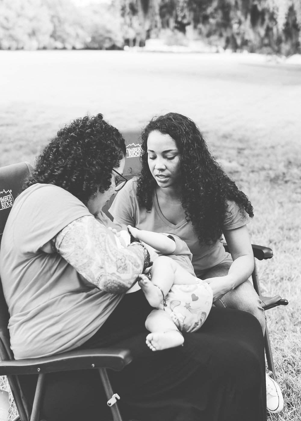 Doula at park with baby giving lactation advice