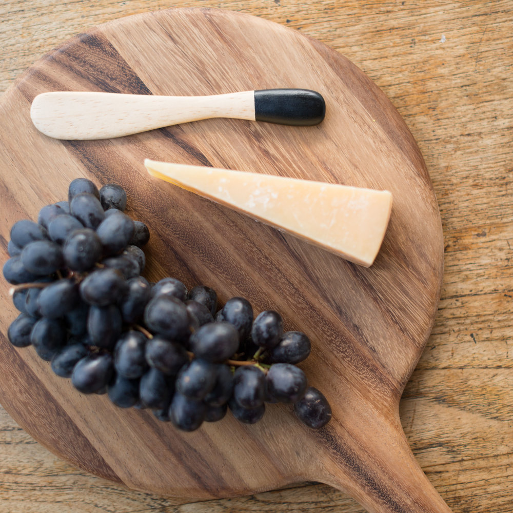 CUTTING BOARD | $40 - This wood cutting board is a wonderful gift for someone who enjoys cooking and entertaining. Because it's made from natural materials, each cutting board also has its own unique character and