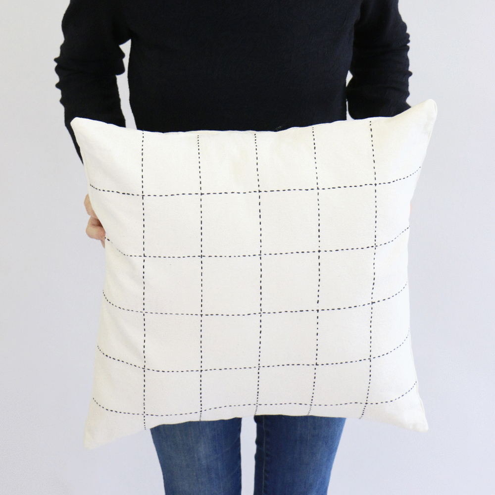 SIMPLE PILLOW COVER | $52 - One can never have too many pillows ... Am I right? Hand-stitched from 100% certified organic cotton canvas, this pillow features a minimal geometric grid design and is the perfect accent piece to toss on the couch, chair, or bed!HOW YOU GIVE BACK | Your purchase supports Anchal, which provides primarily female artisans with design and skills training, full-time employment, educational workshops, health services, a supportive community and access to an international marketplace. By offering alternatives to dangerous and exploitive work, Anchal helps women rediscover their dignity, independence, and creativity in a financially rewarding way.