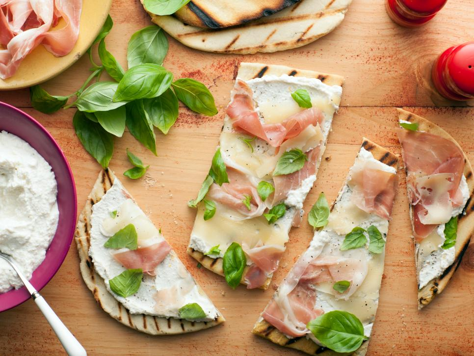 """Giada says, """"Piadini is a lot like a pizza, except that the crust doesn't rise and it's typically cooked on a grill to give it a nice, smoky flavor and crunchy crust. You can top a piadina with anything you like. This sauceless combination is very typical of northern Italy, where piadini are especially popular."""""""
