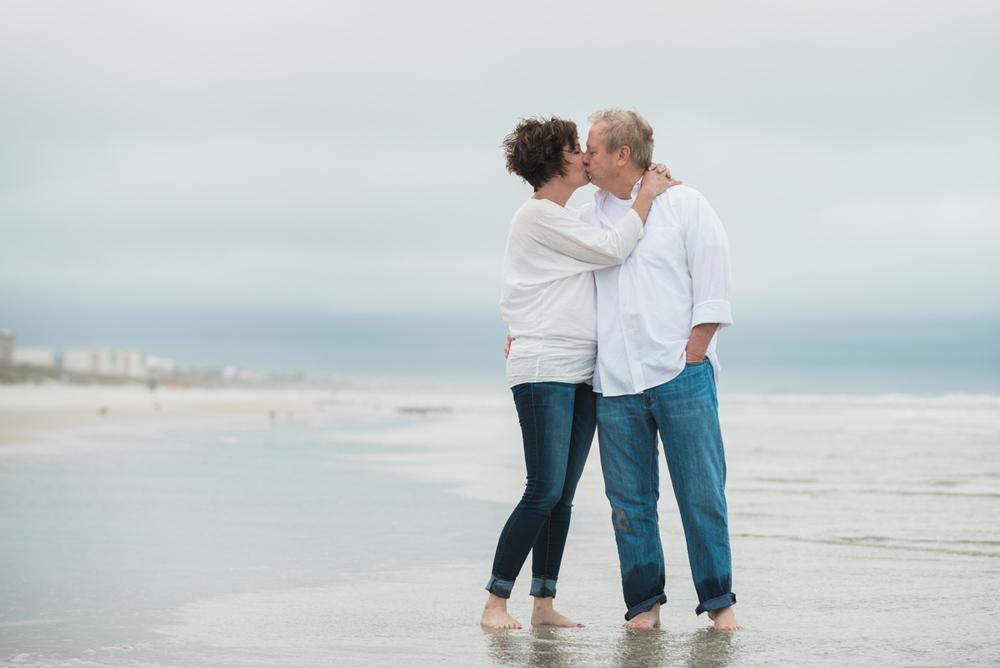 Couple walks on the beach