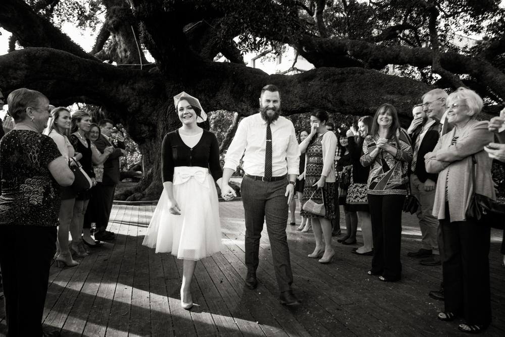 A couple celebrates with family at Treaty Oak