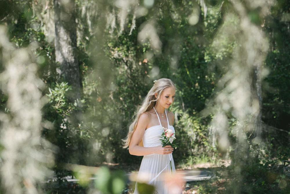 Bride walks to her groom