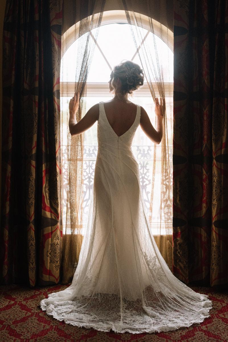 Beautiful bride in window at Casa Monica Hotel