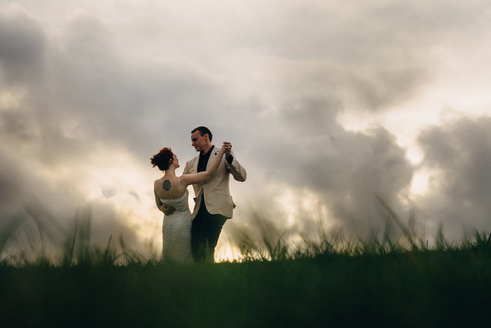 wedding-couple-dramatic-sky.jpg