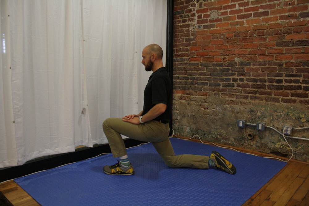 Half-kneeling lunge stretch to improve hip extension on the Right.
