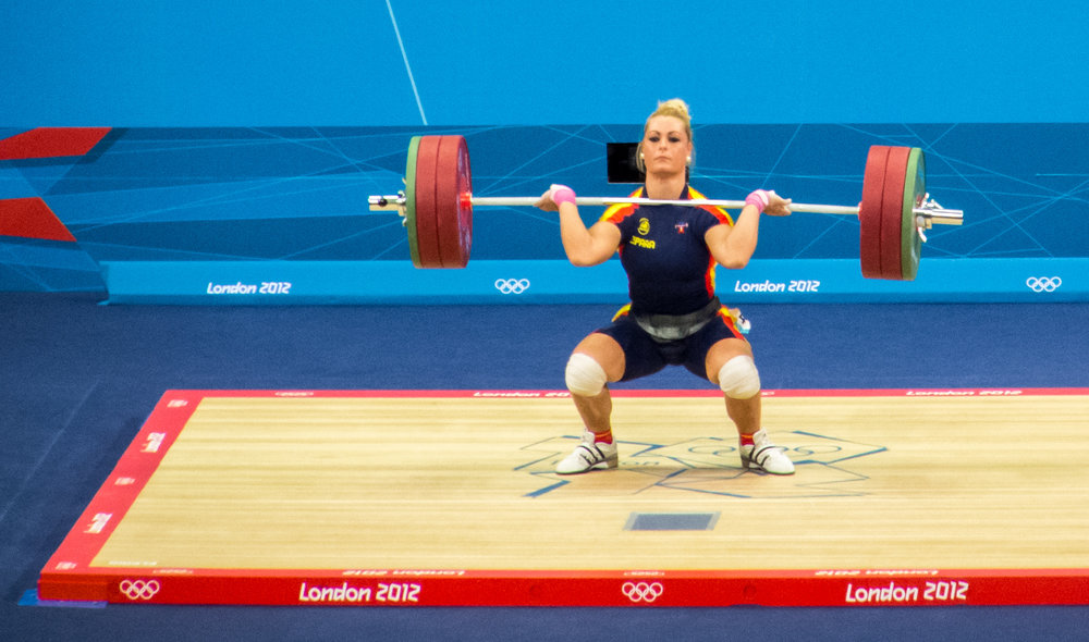 Olympic lifting goes low and elevated heels remove ankle limitations.