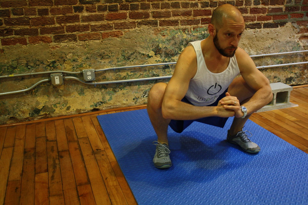 The sumo squat stretch is one way to target tight groin muscles that may limit hip mobility.