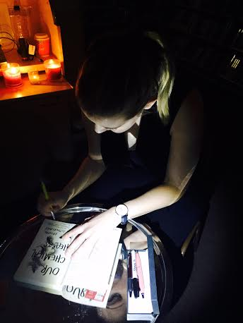 Signing by candlelight. I nearly set my hair on fire twice - after that, the candles had to be moved away from my general vicinity for my own safety.