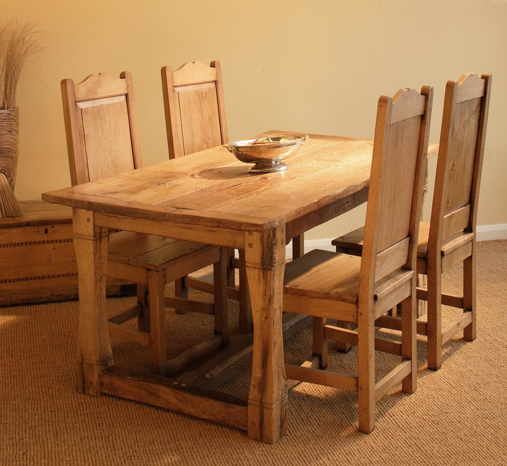 A pale handmade oak refectory table a four dining chairs