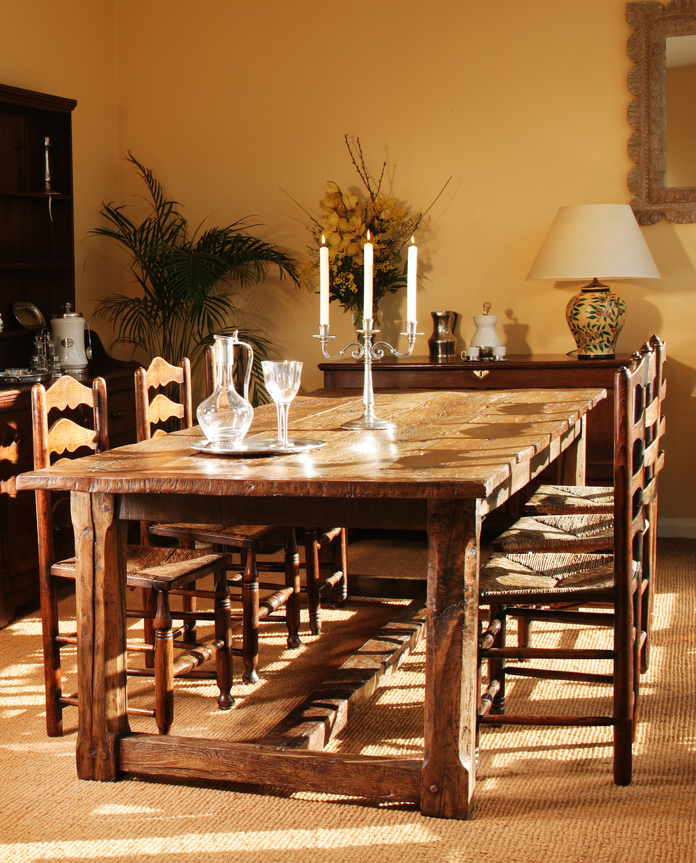 A country oak refectory table and chairs by vincent reed
