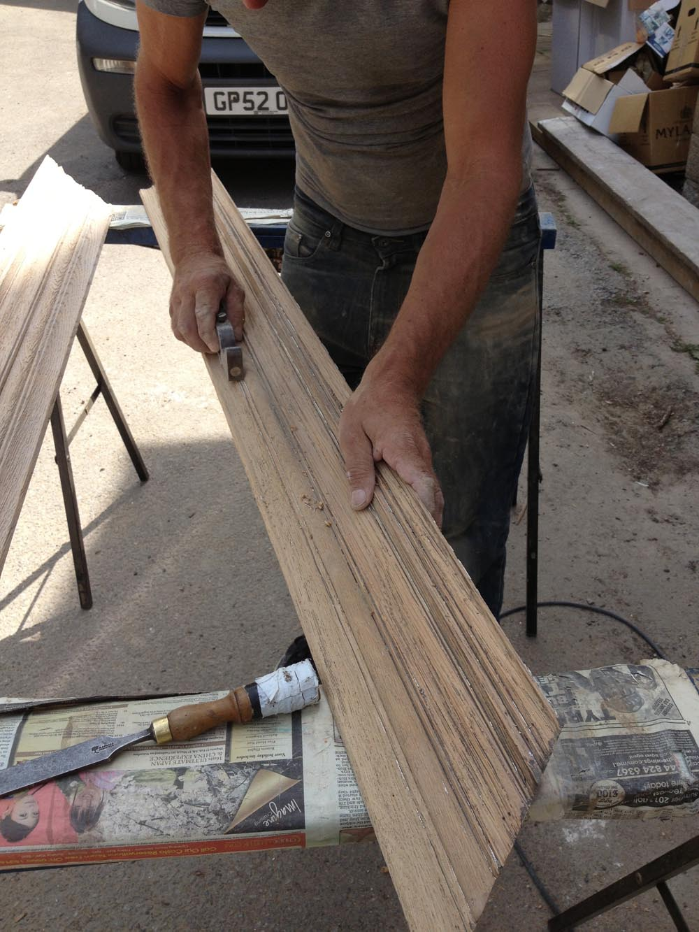 using moulding planes to restore the profile of the original oak cornice
