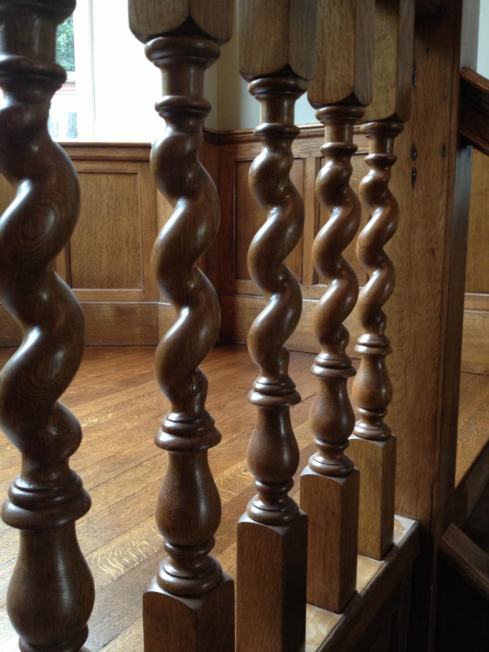 Barley twist oak balustrading after french polishing and waxing