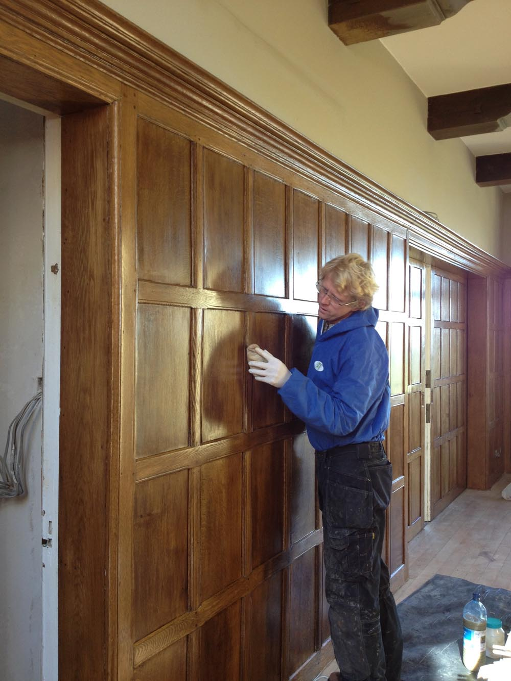 Vincent Reed polishing oak panelling