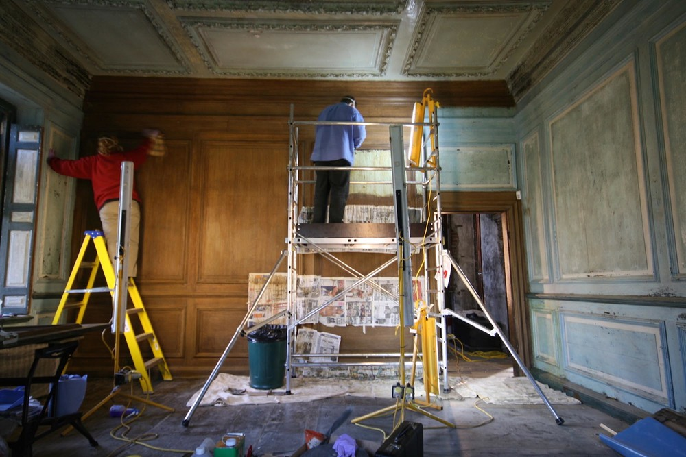 The oak panelled drawing room at groombridge place in kent during restoration