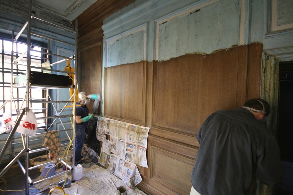 Removing paint from wooden oak panelling during the restoration project near Tunbridge Wells kent