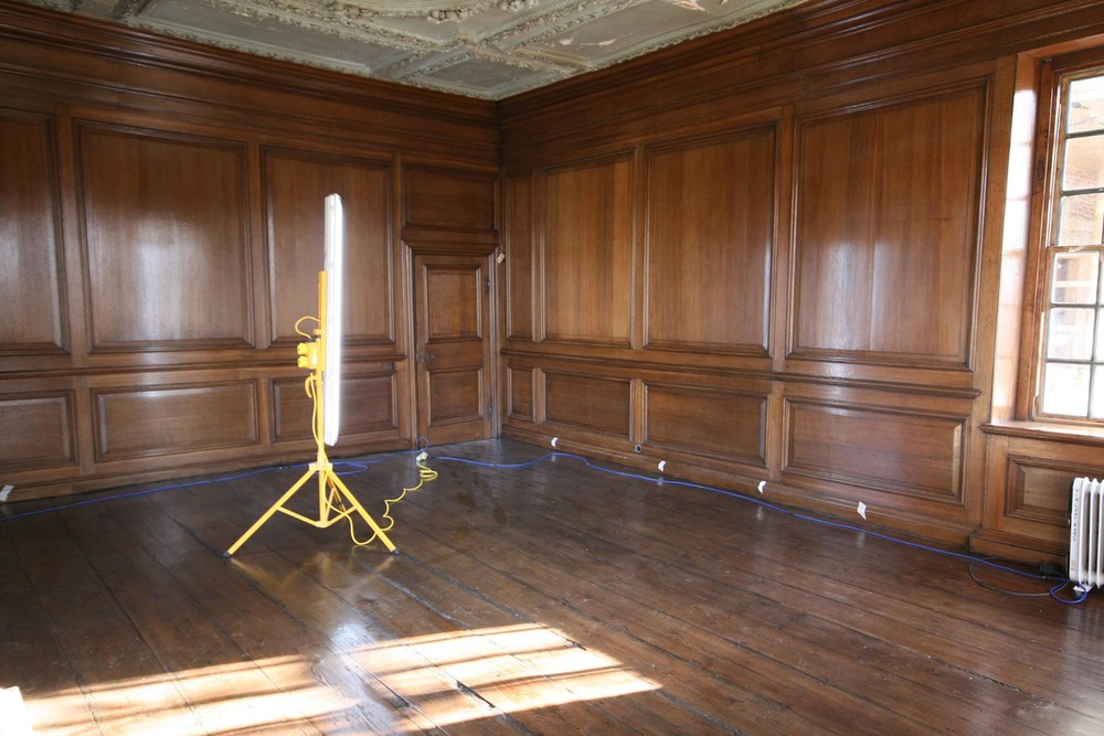 A restored oak panelled room with a natural beeswax finish