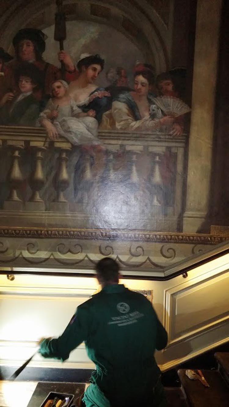 Removing the panelling by Sir Christopher Wren for restoration on the grand kings staircase at Kensington palace London