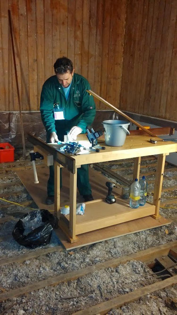 Using a woodworking bench to restore oak panelling in the Privy Chamber at Kensington Palace London