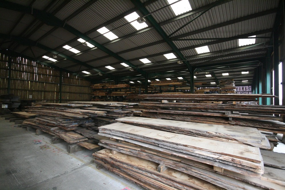 Oak planks before being machined to make flooring at Kensington Palace London