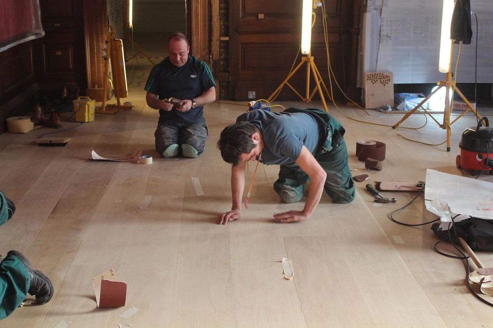 Preparing an oak floor at Kensington Palace London for hand finishing