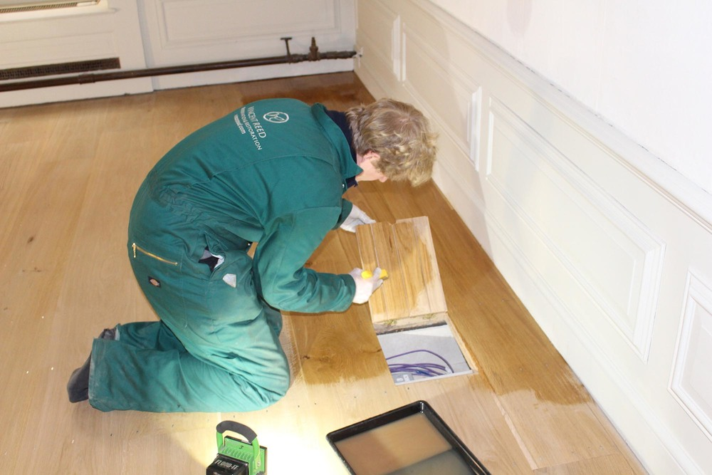 Applying a coat of oil to the floor boxes