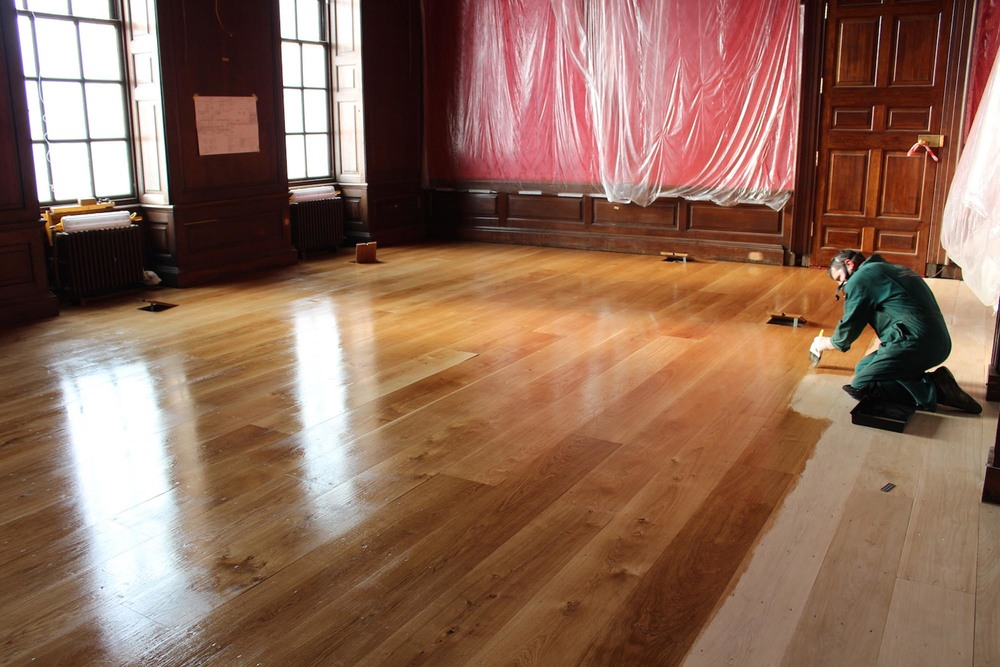 Finishing the oak floor by hand using Osmo Oil - The Privy Chamber at Kensington Palace London
