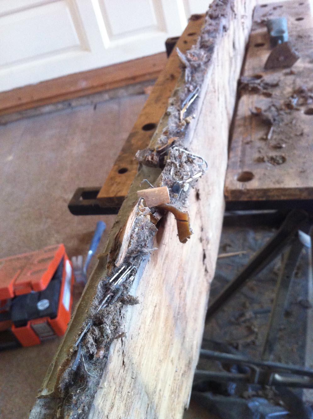 Showing debris found in between the gaps in the oak floor boards