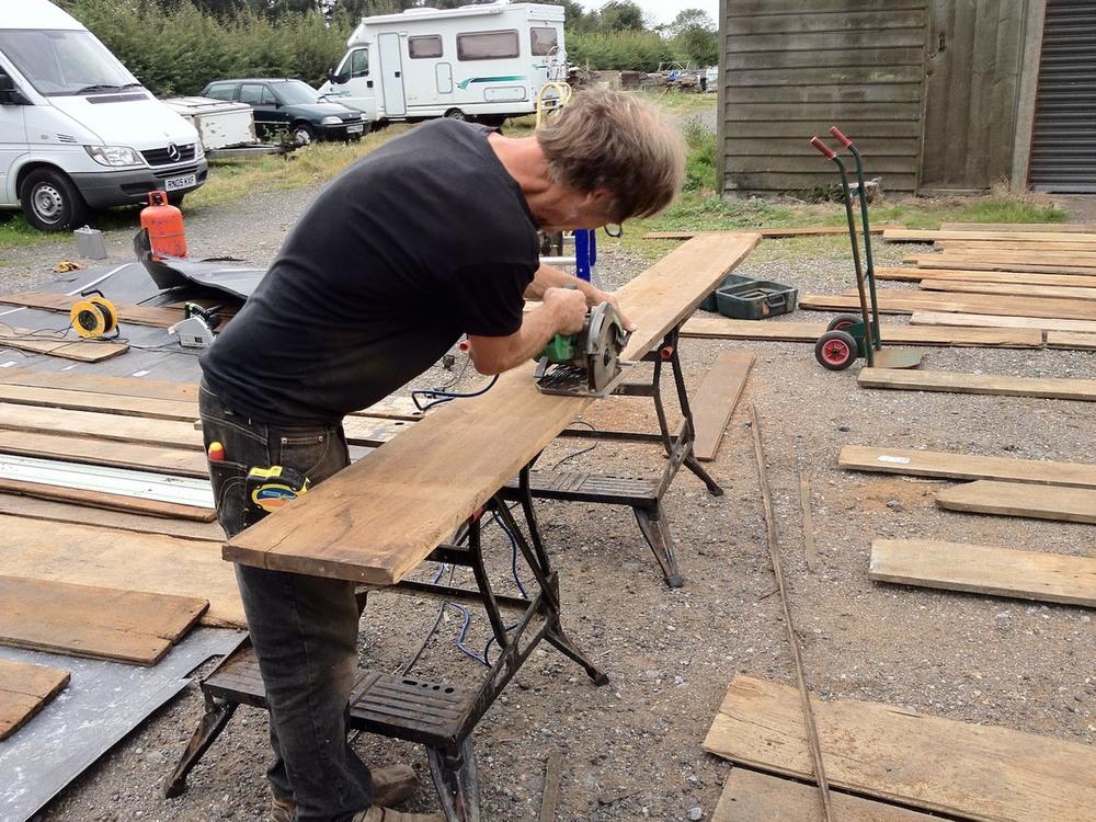 Preparing each reclaimed oak floorboard