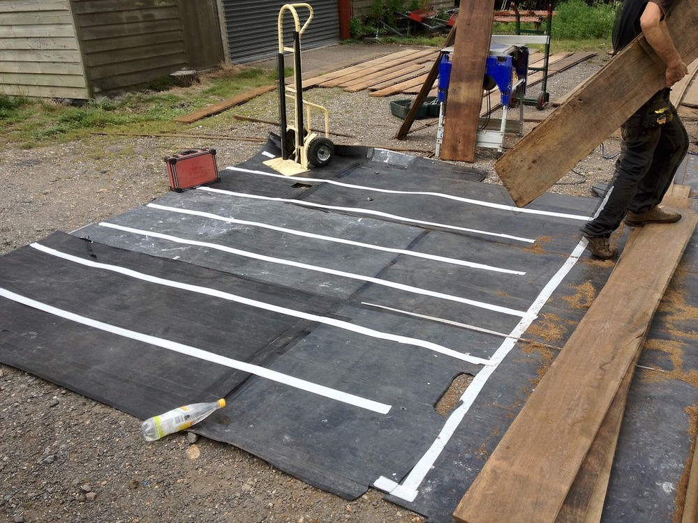 Setting out the reclaimed oak flooring using a template
