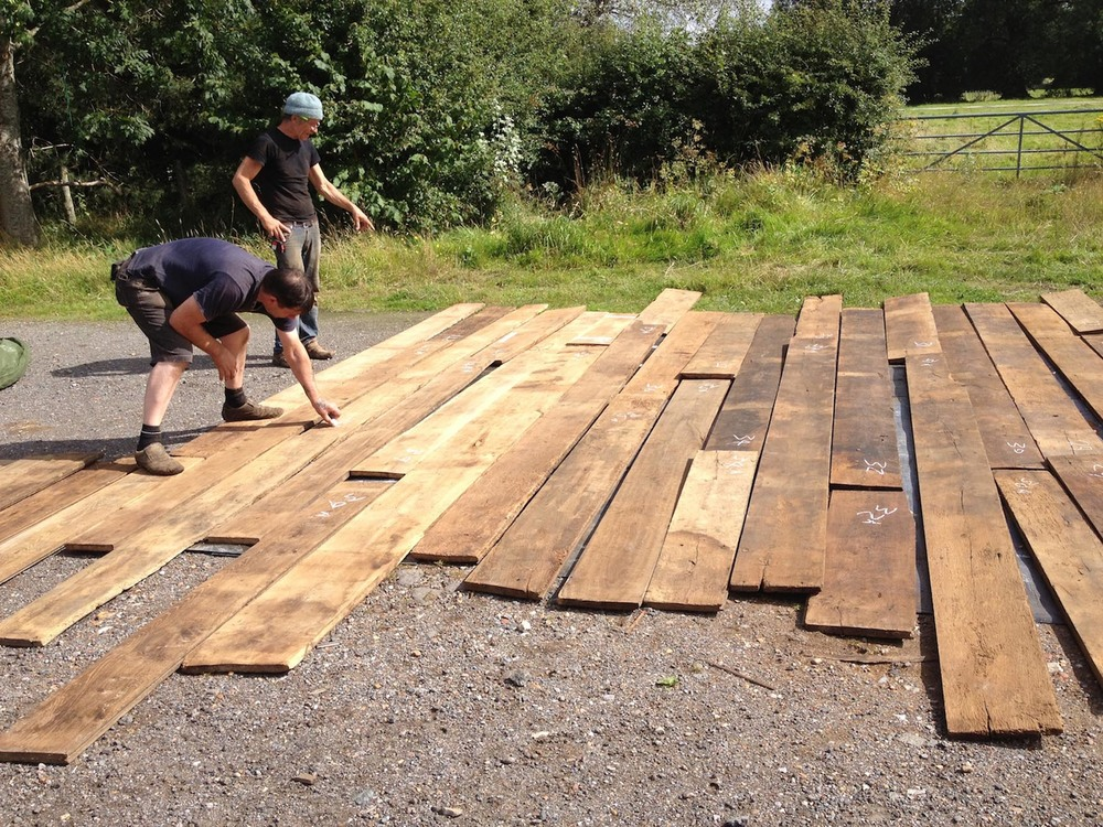 Selecting oak reclaimed flooring before the fitted can begin in Oxted Surrey