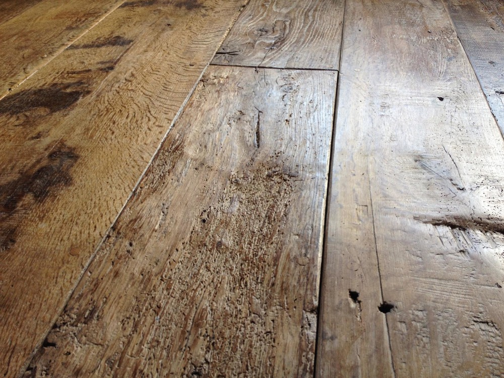 Reclaimed oak flooring finished by hand