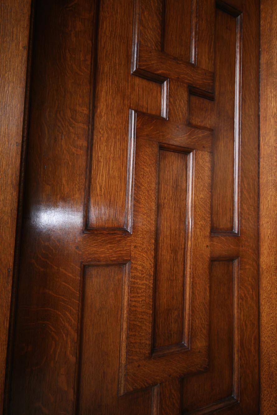 CLose up of an oak panelled door after restoration