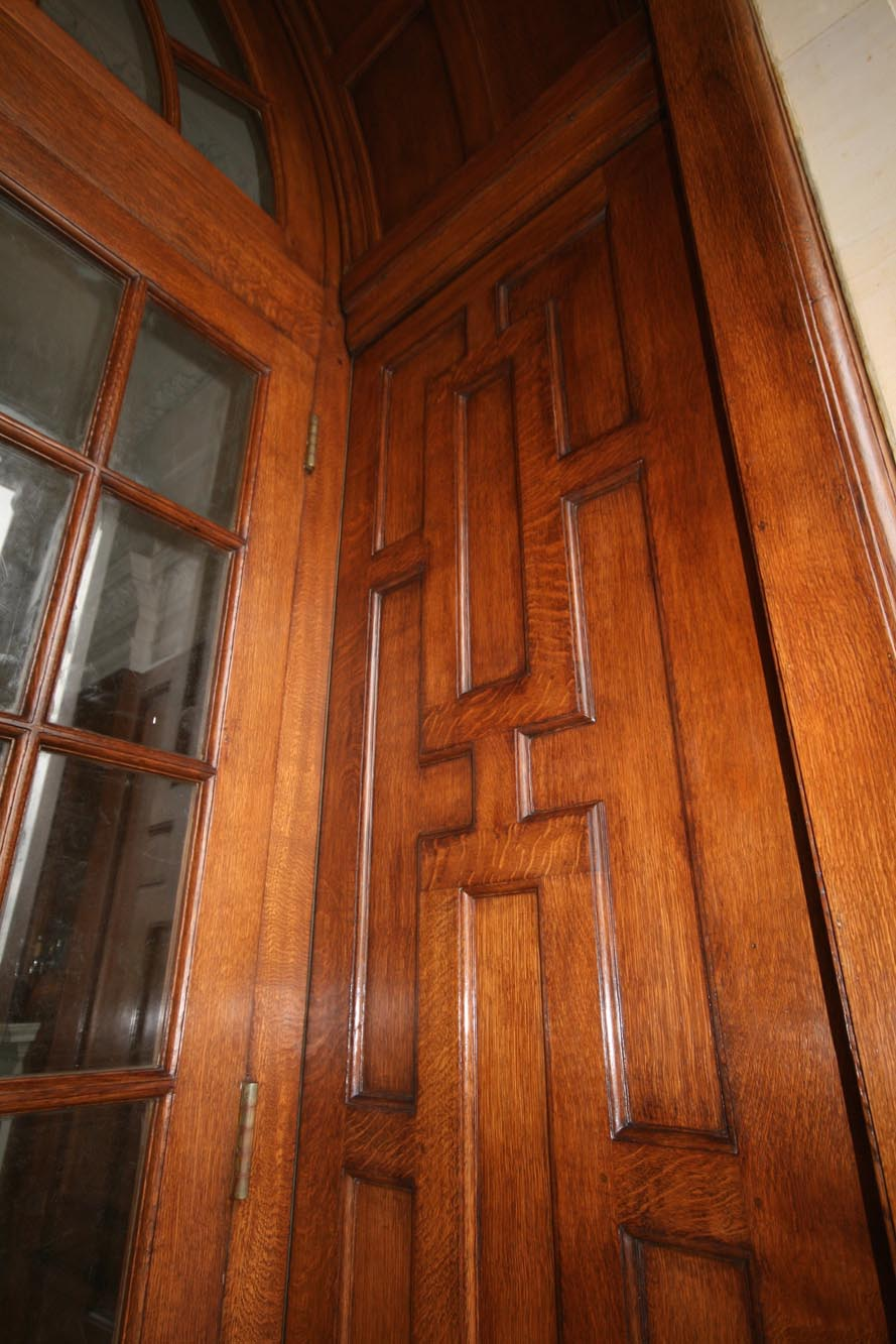 A glazed oak panelled door finished by hand