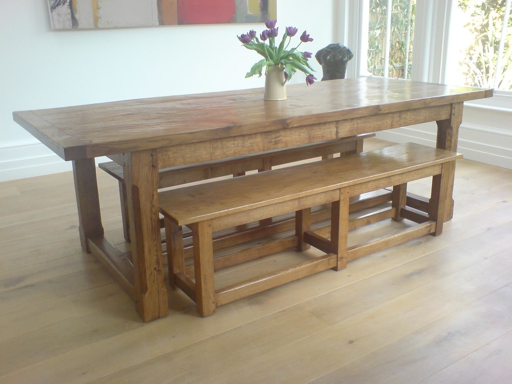 a rustic oak dining table and benches made from english oak in kent