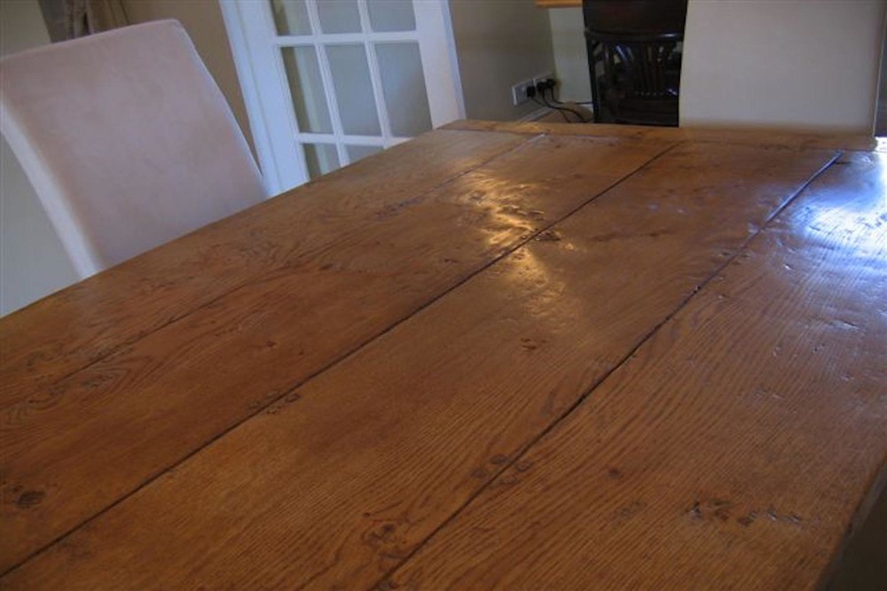 a large oak dining table using three planks to make the top - made for a client in tenterden in kent